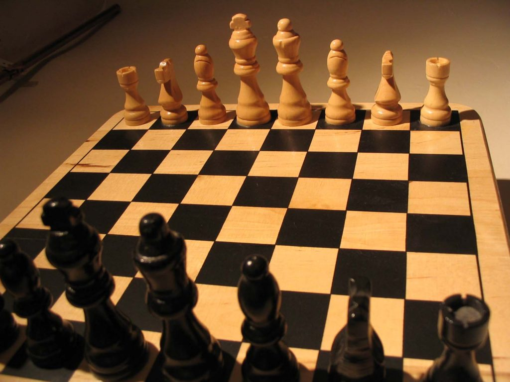Chess art. A chess board in starting configuration with no pawns.