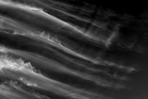 Black and white photo of streaks of high altitude clouds